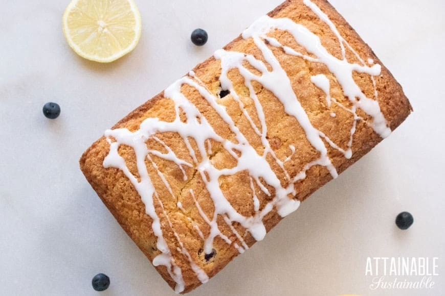 lemon blueberry loaf cake from above, drizzled with glaze