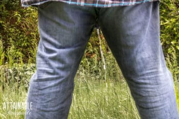 man urinating, from behind