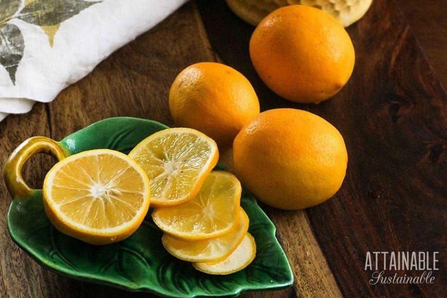 meyer lemons on a green leaf-shaped dish