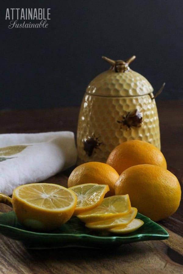 slice meyer lemons with a beehive vintage honey pot