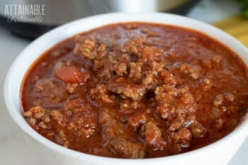bowl of meat sauce with instant pot behind
