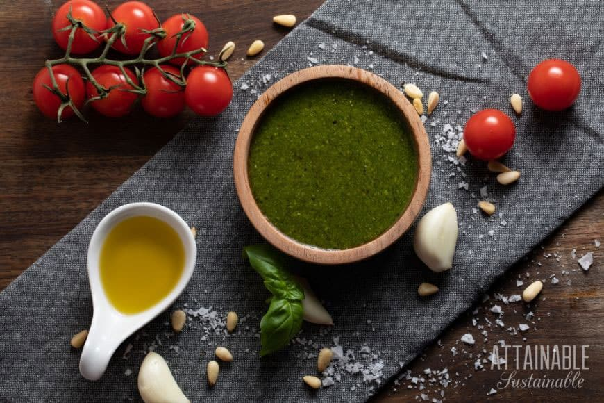 food ingredients from above: oil, cherry tomatoes, a bowl of green sauce