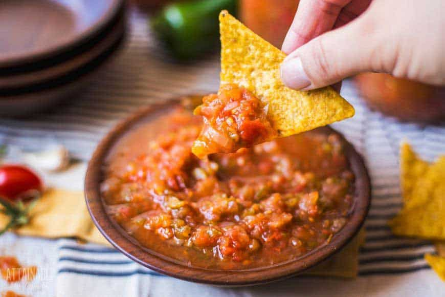 bowl full of salsa with yellow chip