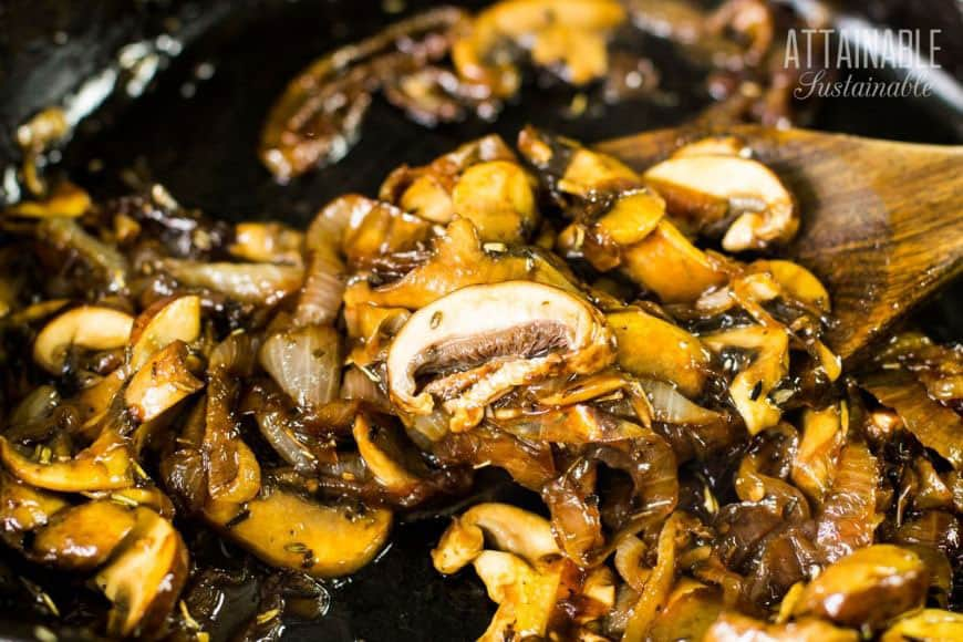 mushrooms and onions on a wooden spoon