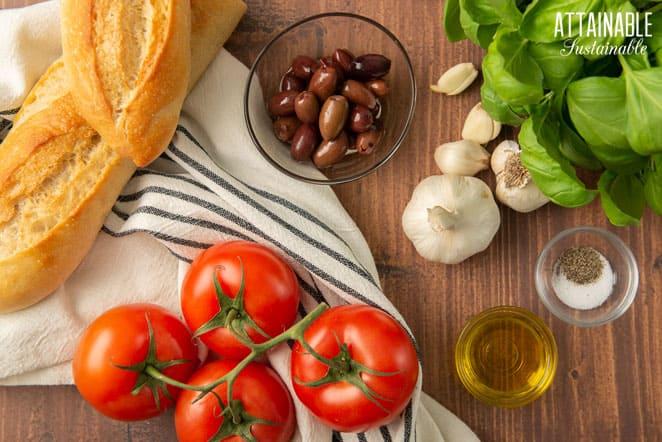 ingredients: bread, tomatoes, olives, garlic, fresh basil, oil, salt and pepper
