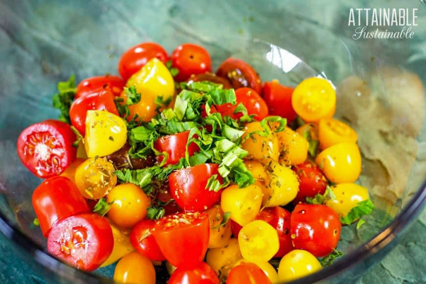 yellow and red cherry tomatoes in a clear bowl