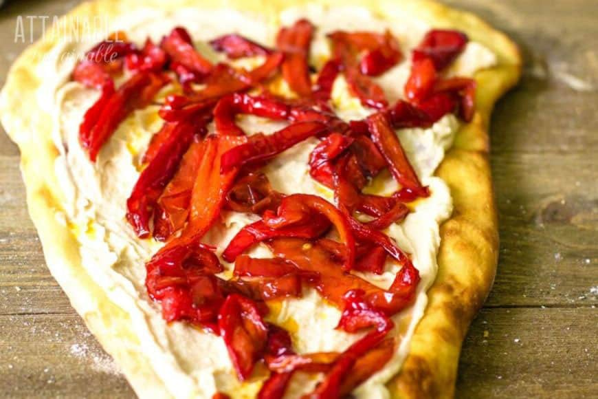 hummus pizza with red peppers