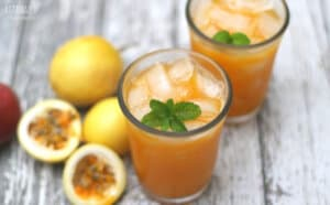 passion fruit juice in two glasses with mint