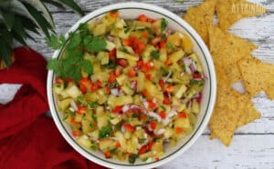 bowl of pineapple salsa with chips, from above
