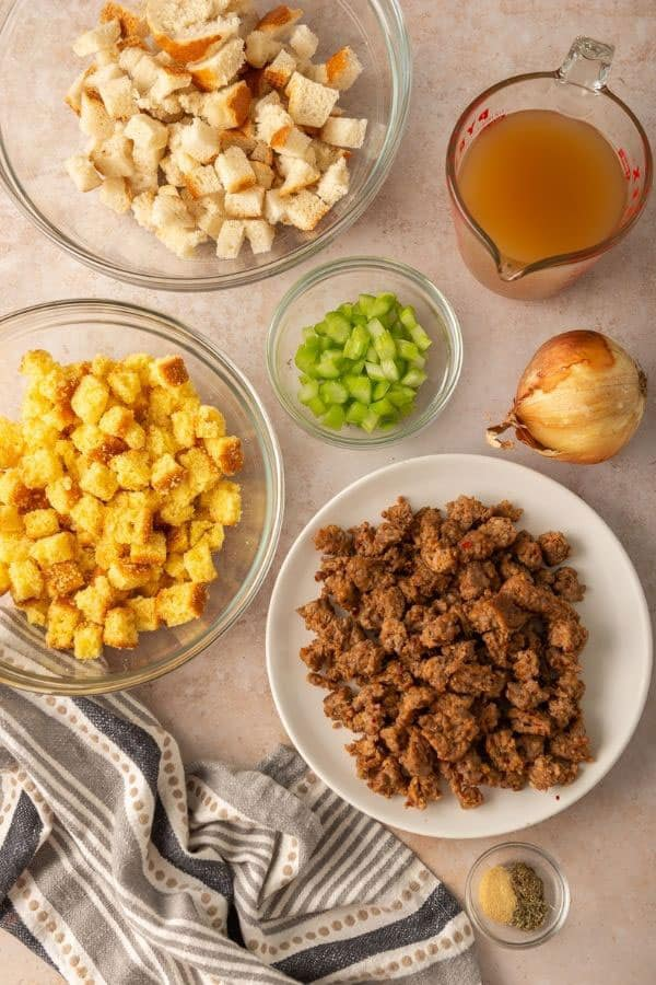 ingredients for stuffing: white bread cubes, cornbread cubes, celery, sausage, broth, spices