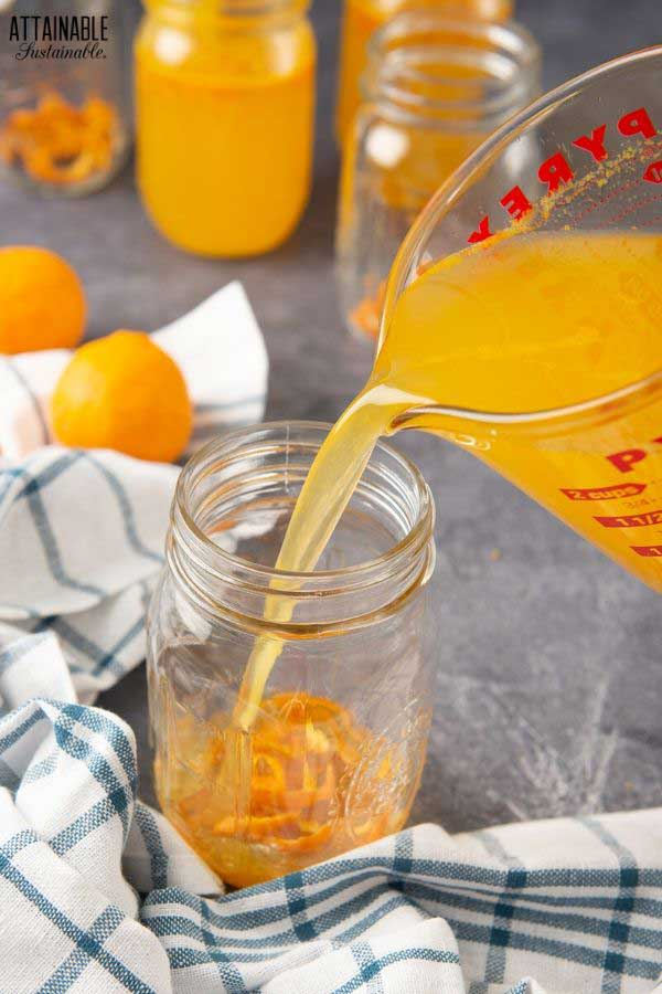 pouring juice into a glass jar