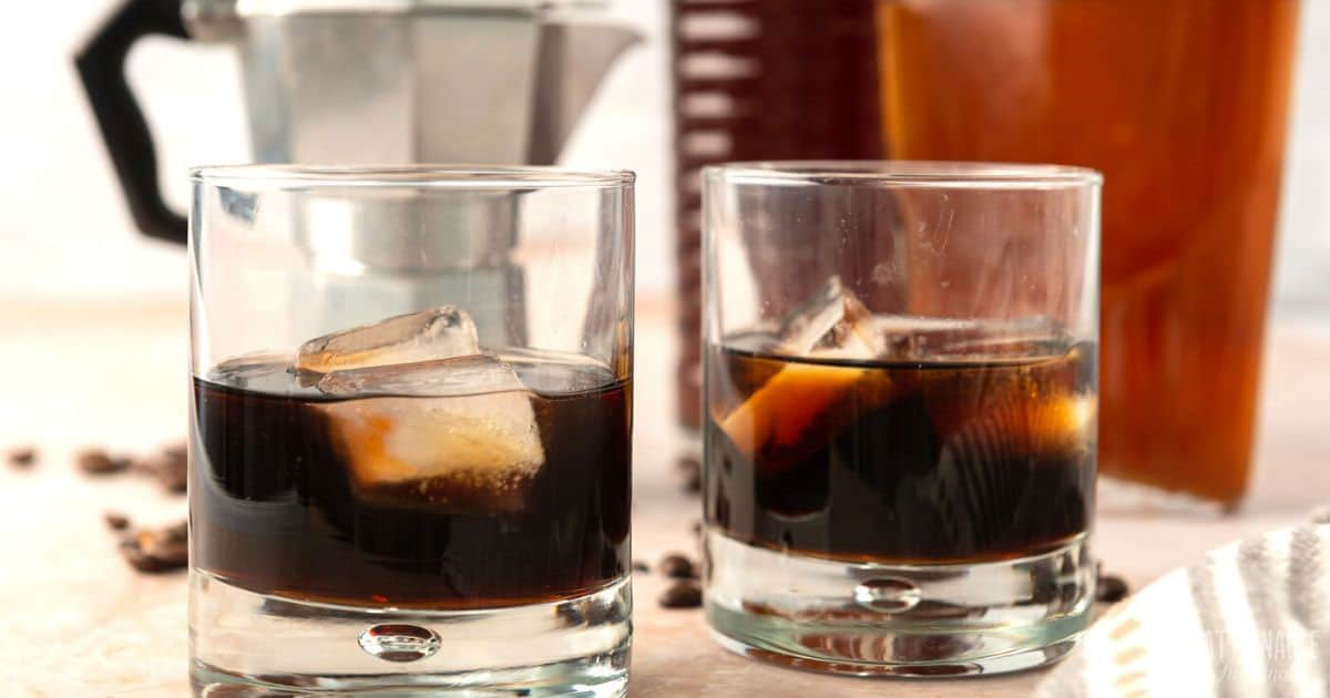 two highball glasses with kahlua and ice