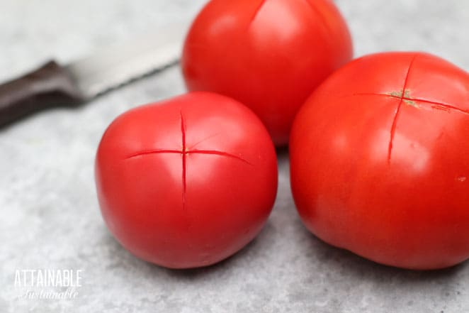 3 red ripe tomatoes with a thin X slashed in them