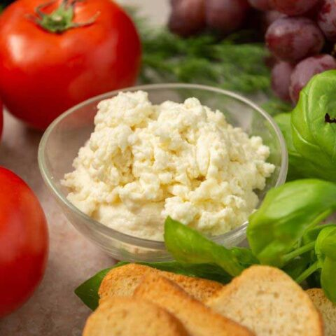 homemade ricotta cheese in a glass bowl