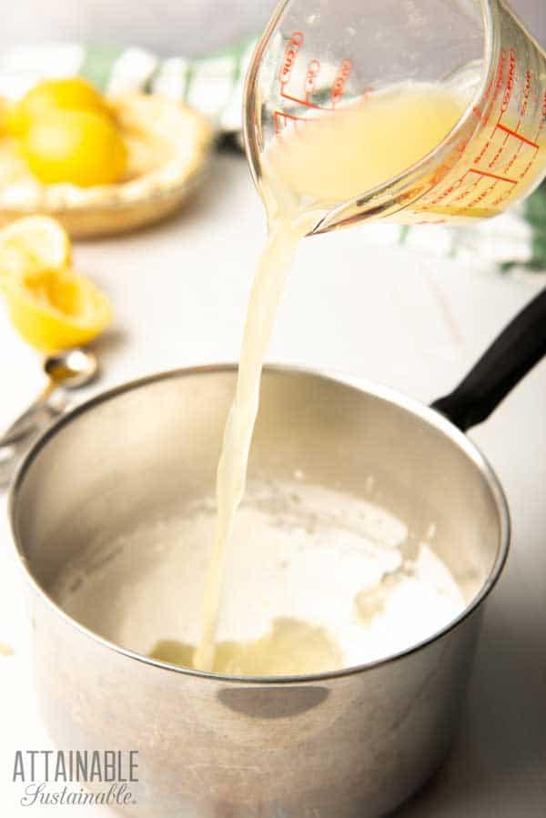 pouring lemon juice into a pot