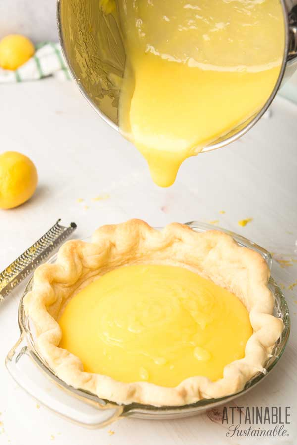pouring pie filling into a pie crust