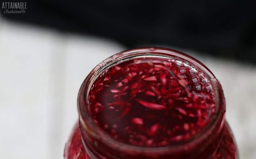 jar with red beet kraut bubbly