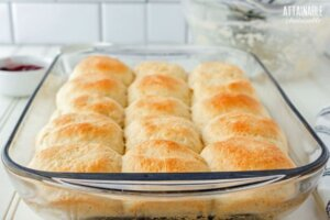 lightly browned dinner rolls in a glass dish