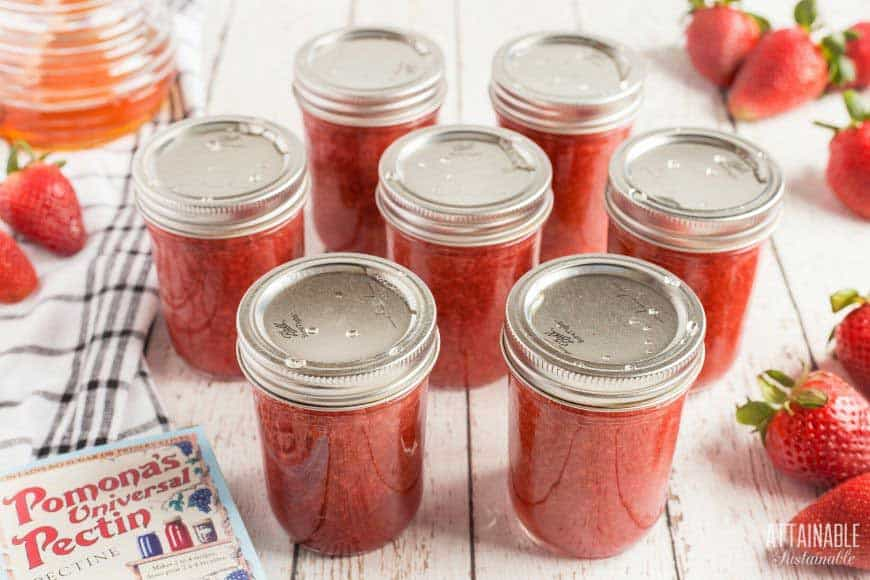 canning jars filled and sealed with strawberry jam