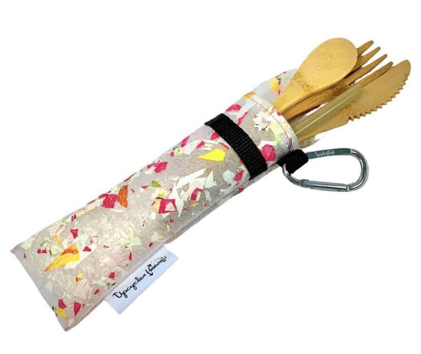 plastic tube holding bamboo utensils