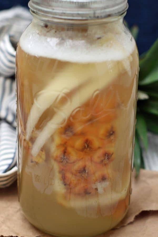 pineapple skins in a glass jar with water
