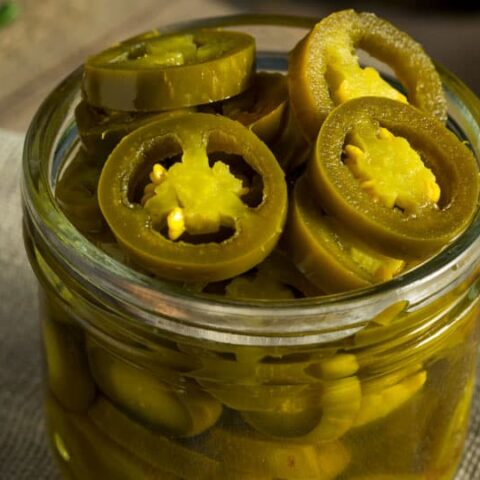 pickled jalapenos in a glass jar