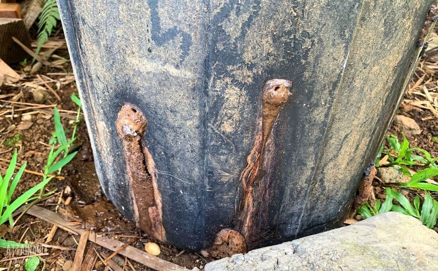 oozing holes on the side of a trash can