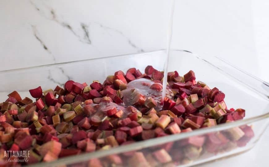 bright red sliced rhubarb in a pan