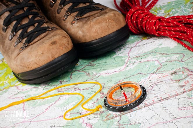 boots on a map with a compass and red rope