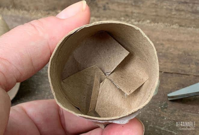 cardboard tube with ends folded in to be a seed starter pot