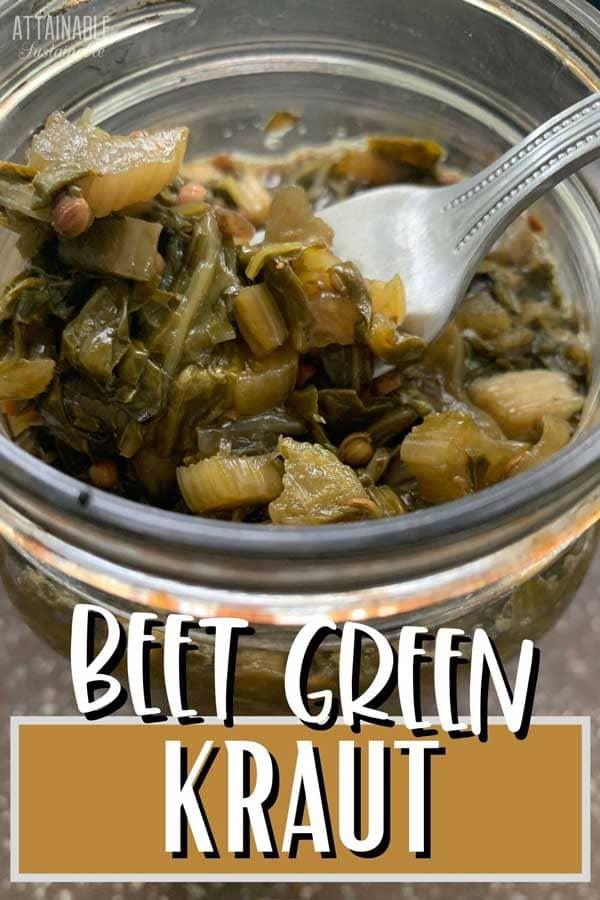 beet green sauerkraut in a jar with a fork