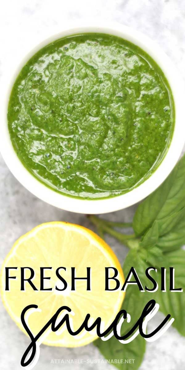 bright green sauce in a white bowl with lemon and basil leaves