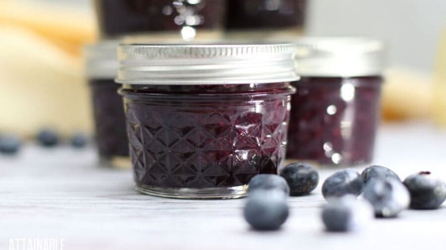 small canning jars of blueberry jam