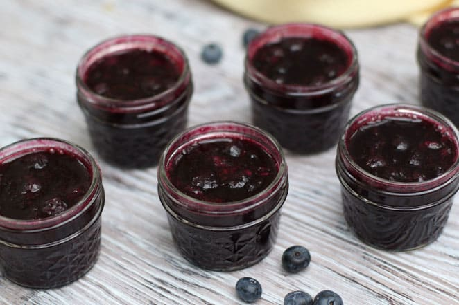 small canning jars filled with jam
