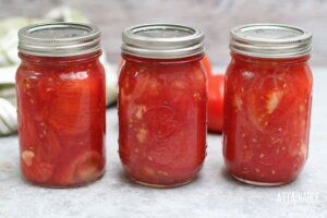 3 jars of crushed tomatoes in canning jars