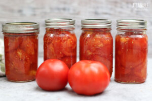 4 canning jars full of crushed tomatoes