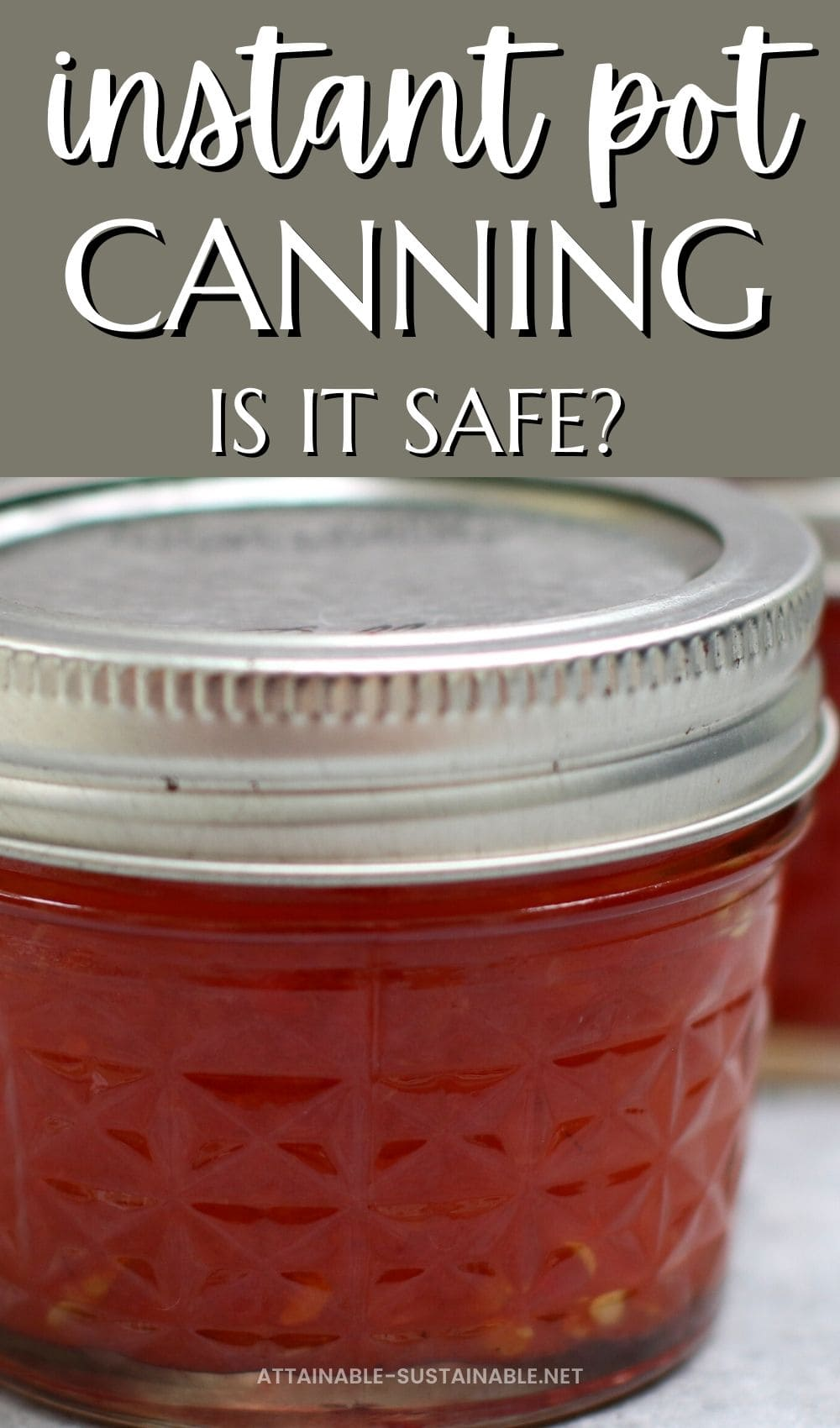 close up of canning jar full of red jam