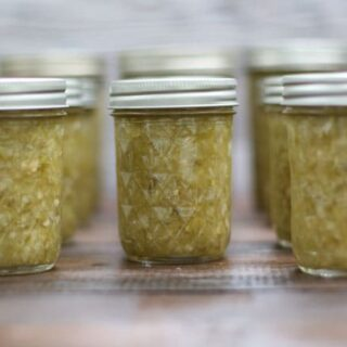 half pint canning jars filled with green tomato relish