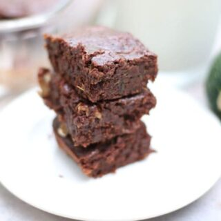 stack of brownies on a white plate