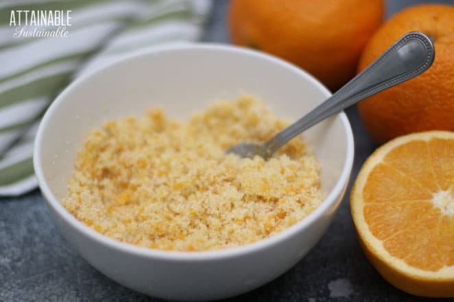 white bowl with orange sugar and a fork