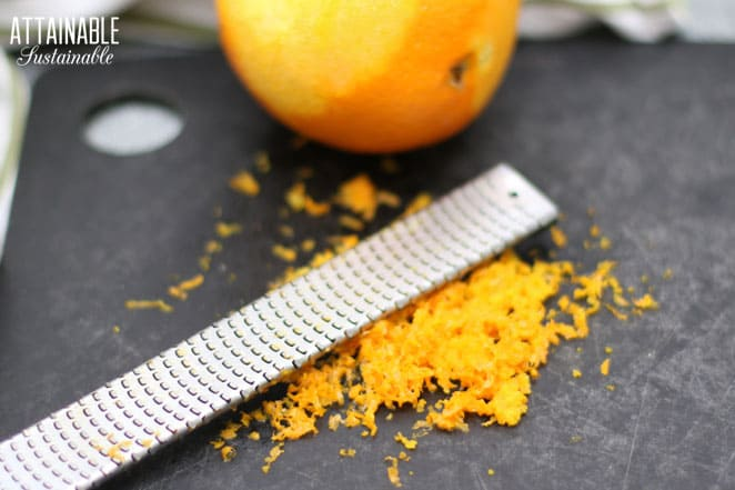 microplane on a cutting board with orange zest